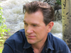 Book Chris Isaak for your next event.