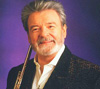 Book Sir James Galway for your next corporate event, function, or private party.