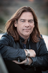 Book Alan Doyle for your next corporate event, function, or private party.